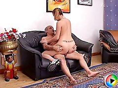 Nubile slut with a sexy tattoo on her waist giving head to a much older man and riding his hairy cock to orgasm